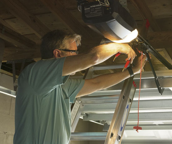 technician repairing a garage door line